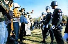 Line Of Police Advances On Protestors Photo Credit Courtesy Of: Avanduyn Public Domain