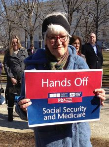 Nurse_holding_red_white_and_blue_sign_-_Hands_Off_Social_Security_and_Medicare